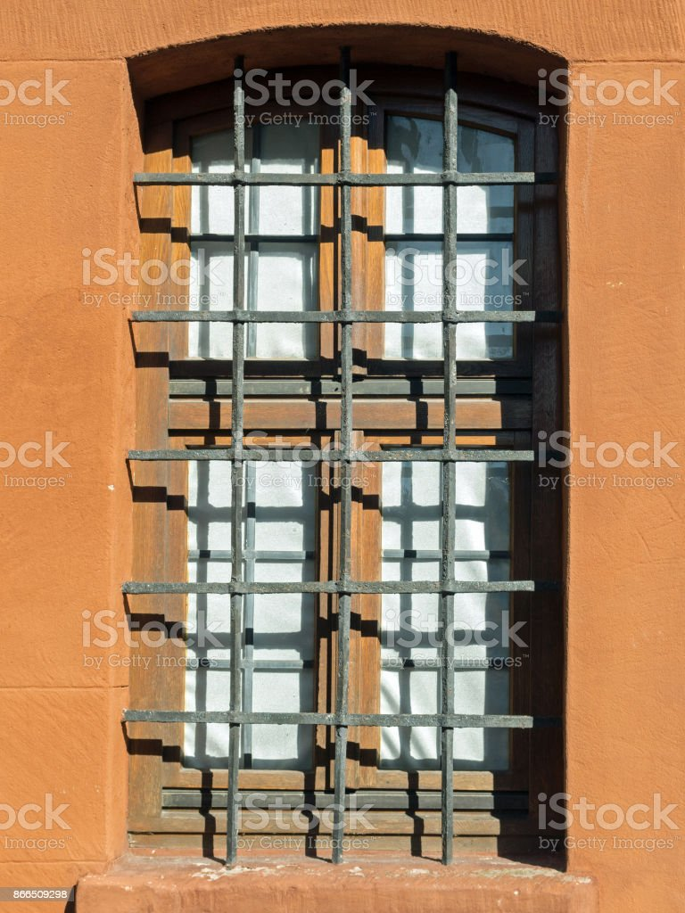 Small Oldfashioned Window With Sandstone Frame And Iron Grid Stock ...