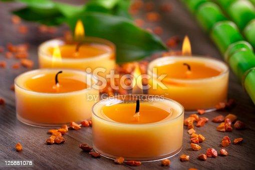 Four orange lit candles arrangement