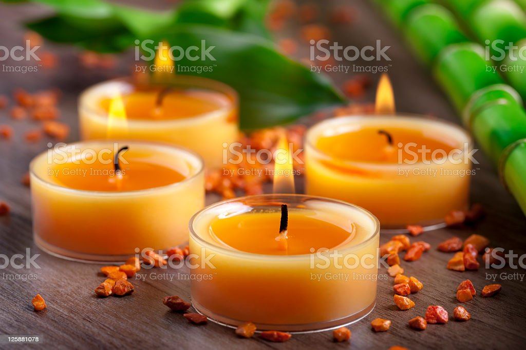 Small orange candles and stones with bamboo decoration stock photo