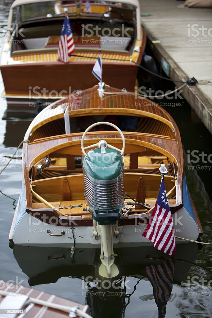 Small outboard on a classic wooden boat stock photo