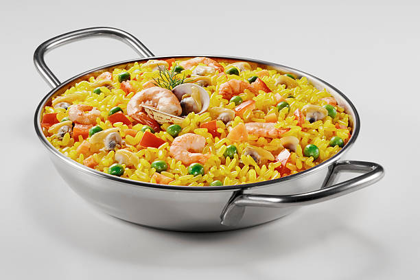 small paella in a pan - paella stock photos and pictures