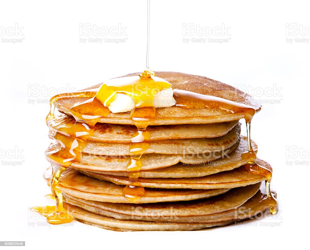 Small pancakes with butter and honey stock photo