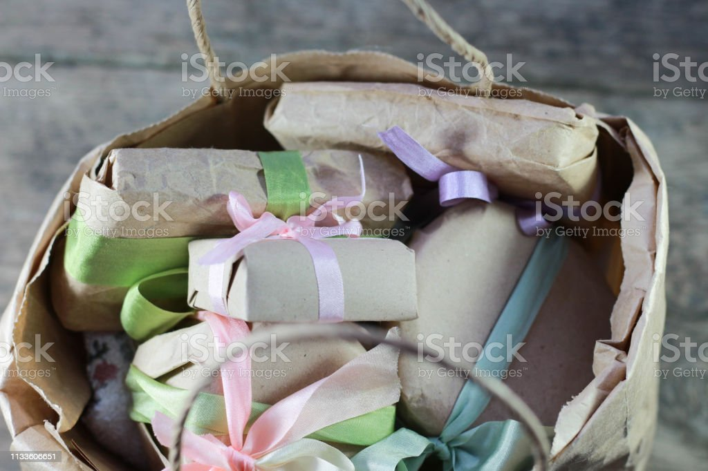 small paper bag with present boxes and flowers, cosmetics