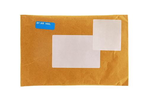 Small paper post packet isolated on the white background. Blank envelope isolated on white background