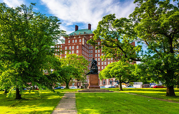 Small park and an apartment building in Baltimore, Maryland. stock photo