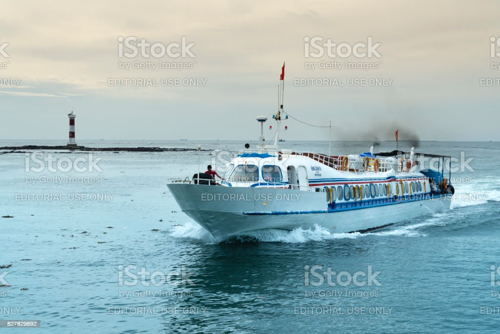 small passenger ship on the way to Ly Son Island stock photo