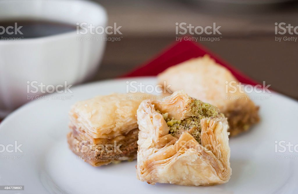 small pastry treats in a white plate. stok fotoğrafı