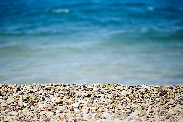Small pebble rock and stone on sea shore stock photo