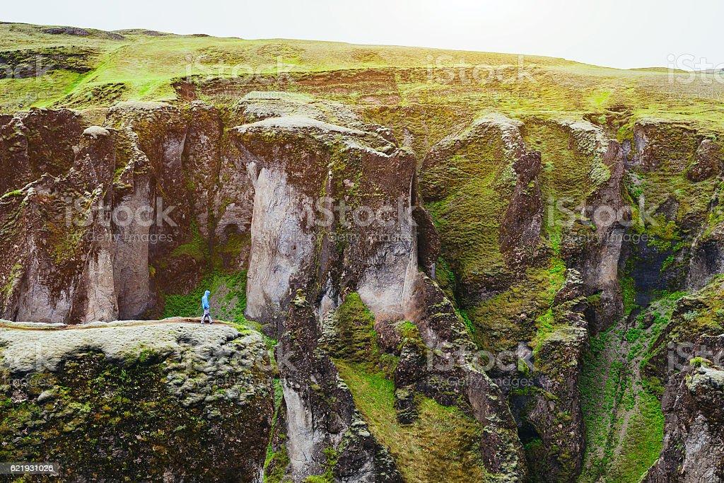 small person in big landscape stock photo