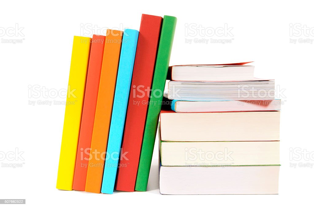 Small pile and leaning row of colorful books isolated stock photo