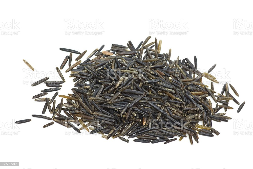 Small pile of black wild rice stock photo