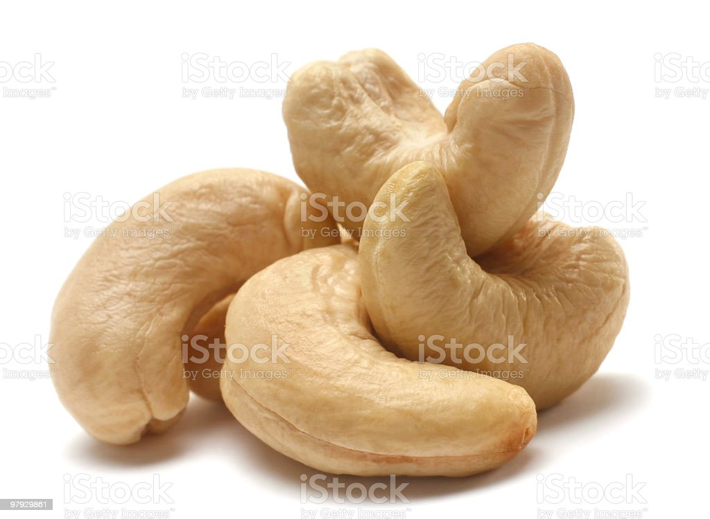 Small pile of cashew nuts on white surfaces royalty-free stock photo