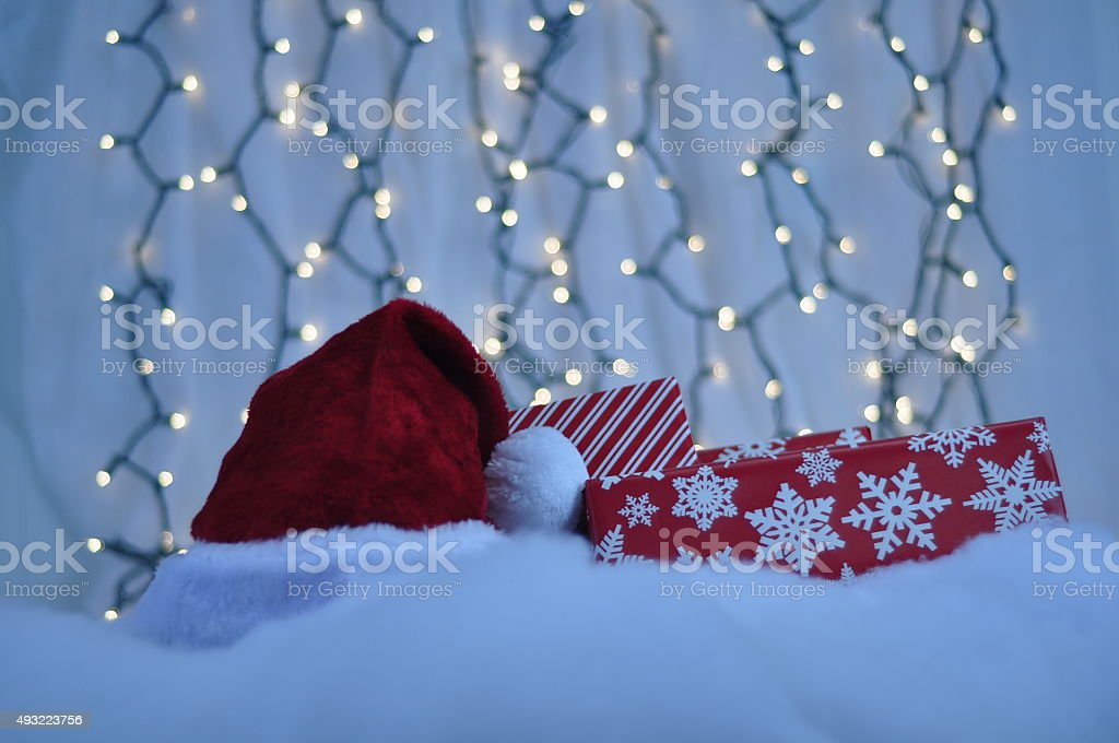 Small pile of Christmas presents with Santa Hat stock photo