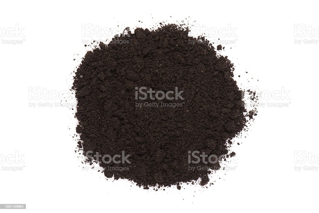 Small pile of dark compost soil on white royalty-free stock photo