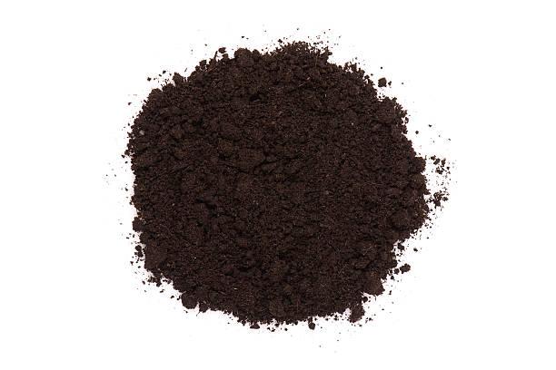 Small pile of dark compost soil on white stock photo