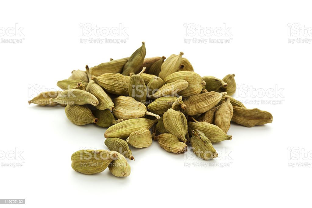 A small pile of green cardamom pods royalty-free stock photo