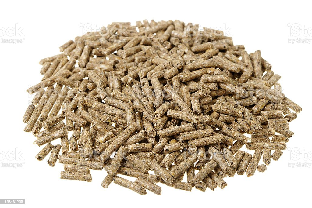 Small Pile Of Pelleted Poultry Feed Isolated On White royalty-free stock photo