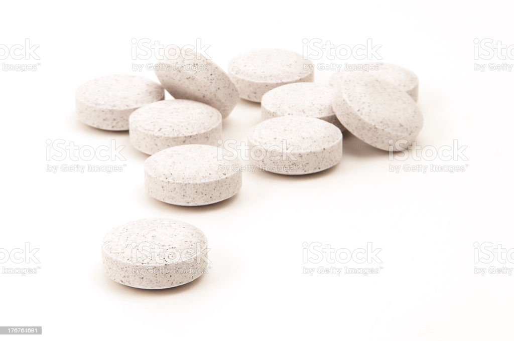 A small pile of vitamin C tablets next to each other  royalty-free stock photo