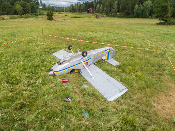 Small plan crashed in a grass field stock photo