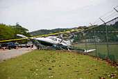small plane crashes through fence in emergency landing