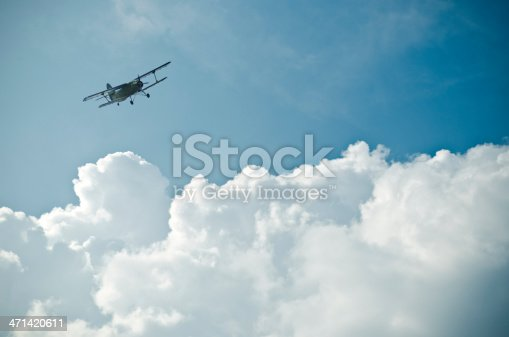 biplane between impressive cloud formation