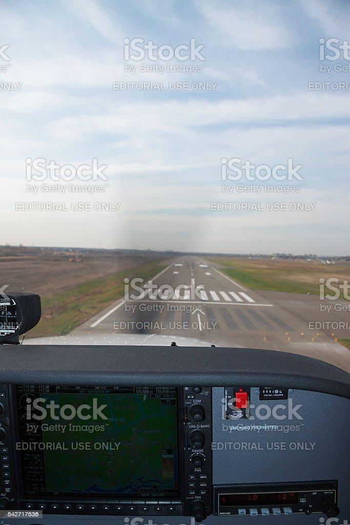 Small plane landing stock photo