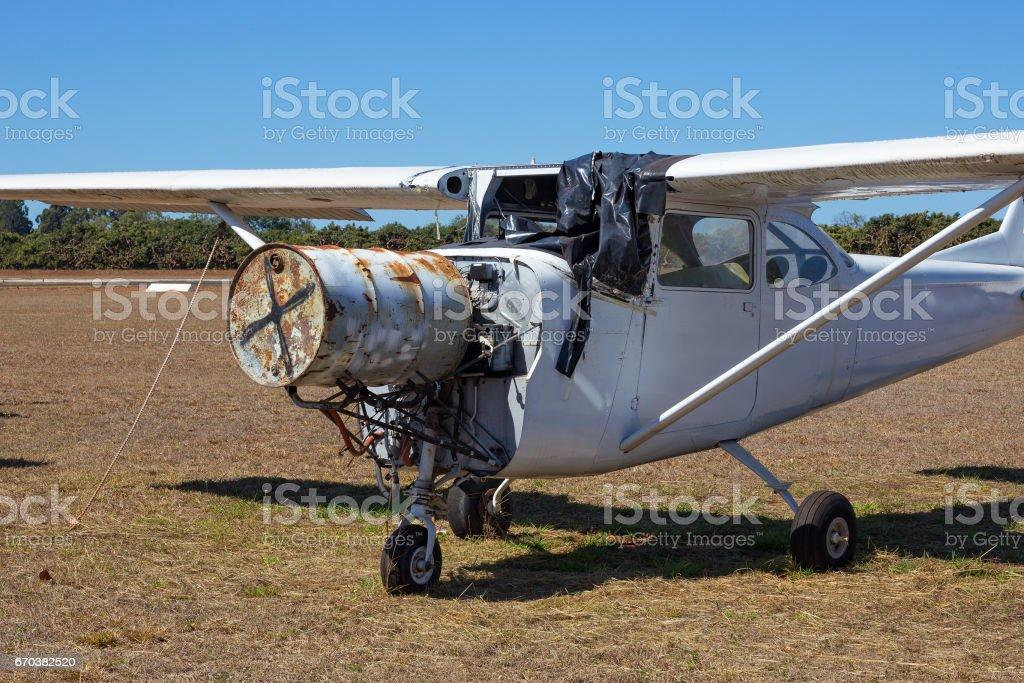 Small plane needing repairs stock photo