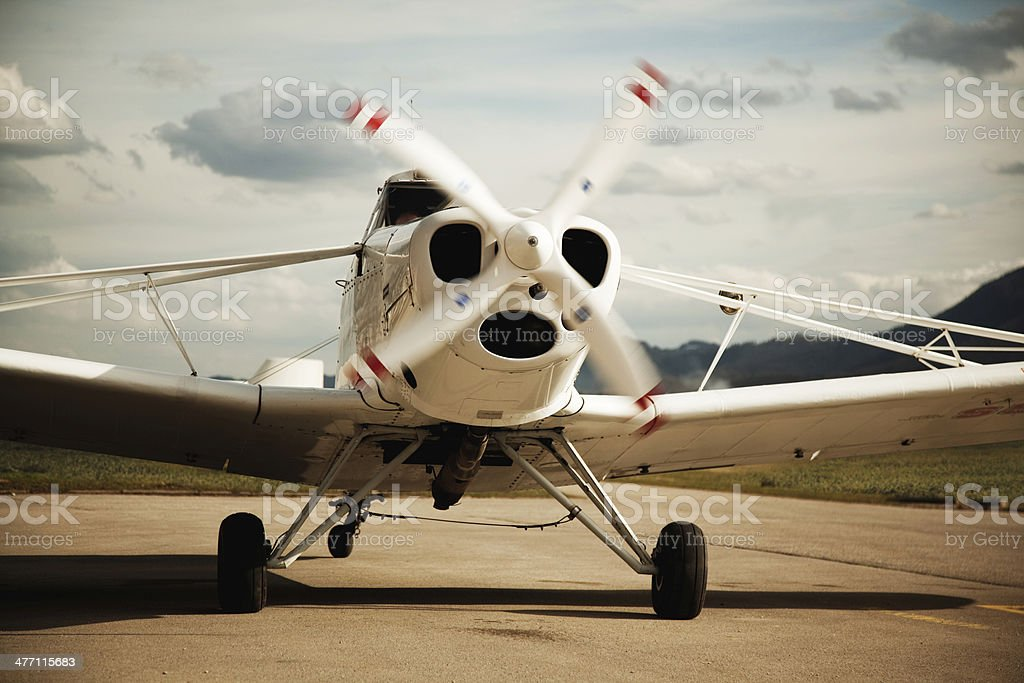 small plane with rotating propeller stock photo