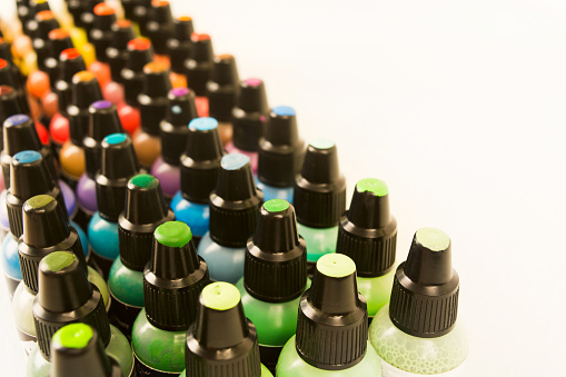 istock Small plastic bottles with colorful paint for arts with samples on cover 1038605890