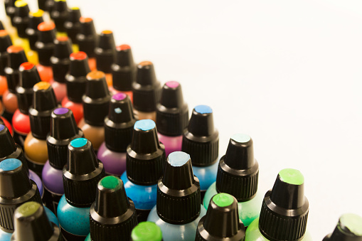 istock Small plastic bottles with colorful paint for arts with samples on cover 1038606278