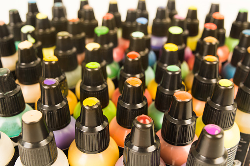 istock Small plastic bottles with colorful paint for arts with samples on cover 1038606332