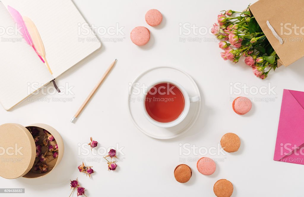 Small porcelain cup filled with tea stock photo