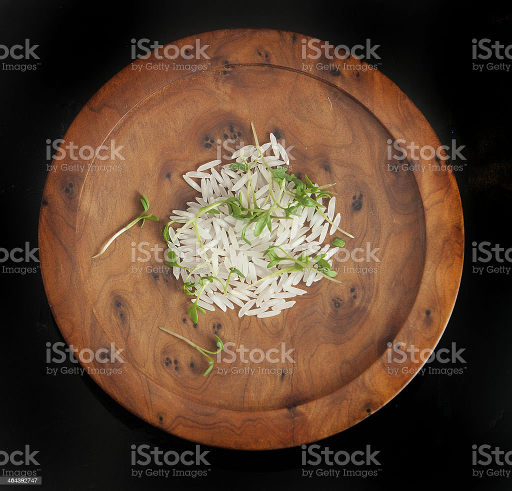 small portion of rice on wodden plate royalty-free stock photo
