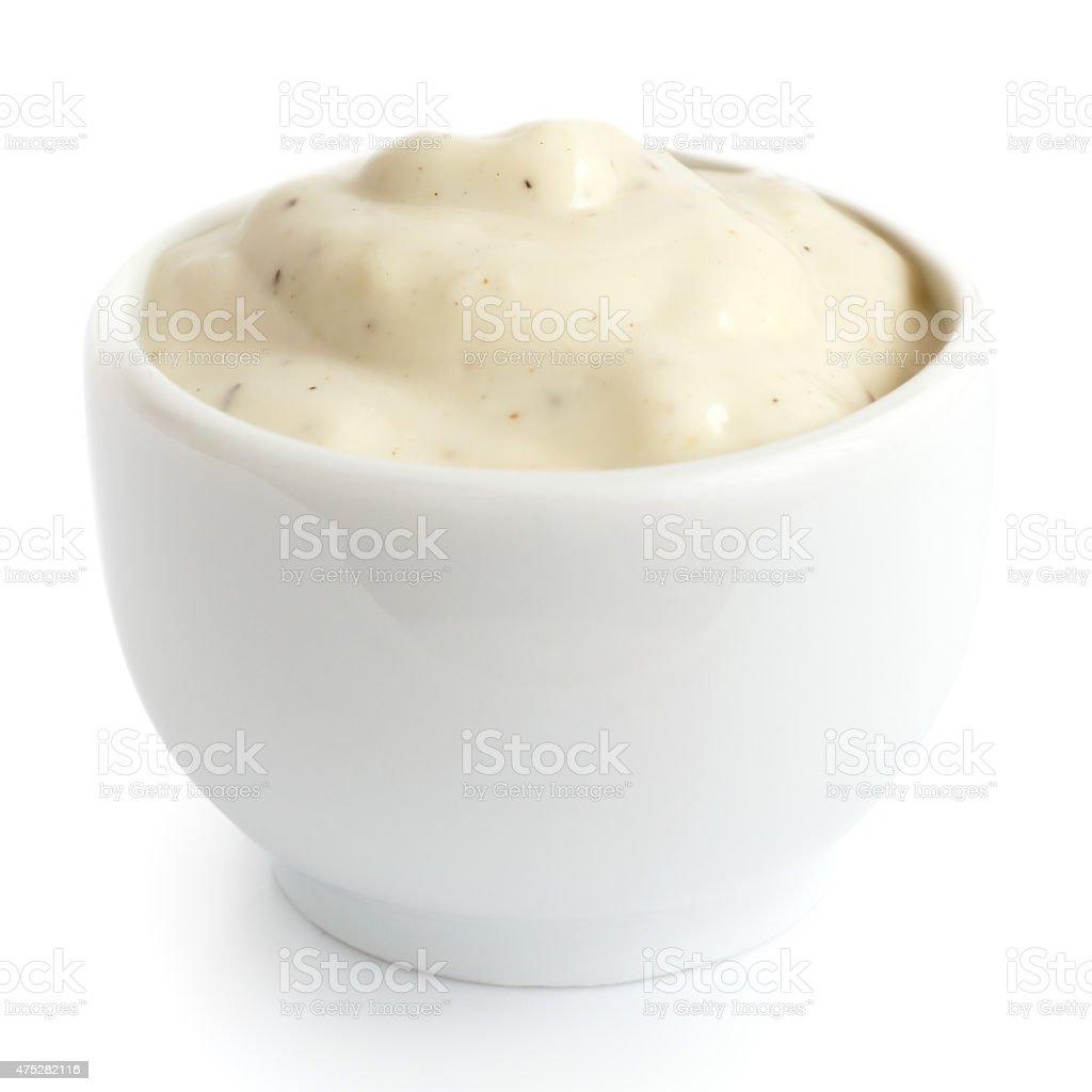 Small pot of garlic mayonnaise dressing, isolated, detail. stock photo