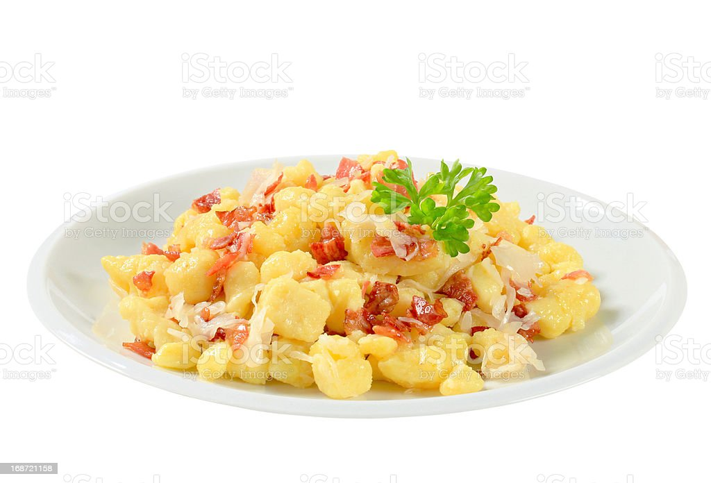 Small potato dumplings with bacon and cabbage stock photo