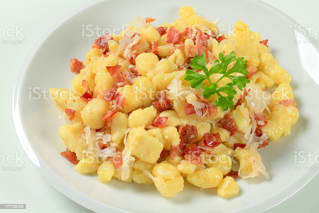 Small potato dumplings with bacon and cabbage royalty-free stock photo