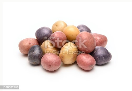 Three colors small potatoes isolated on white