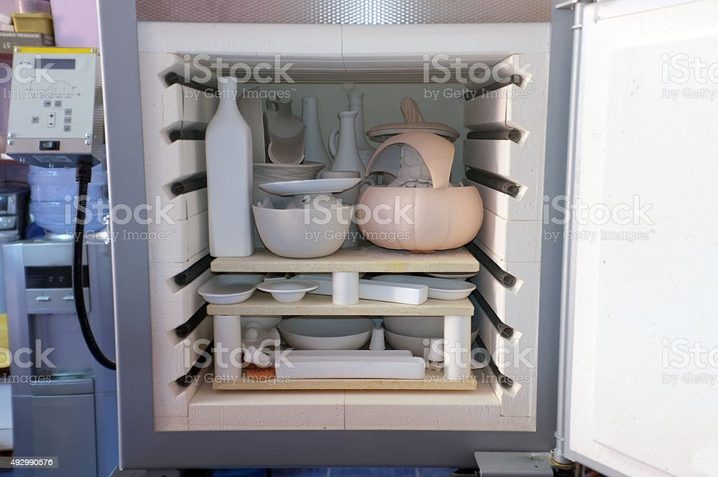 Small pottery oven with ceramics inside stock photo
