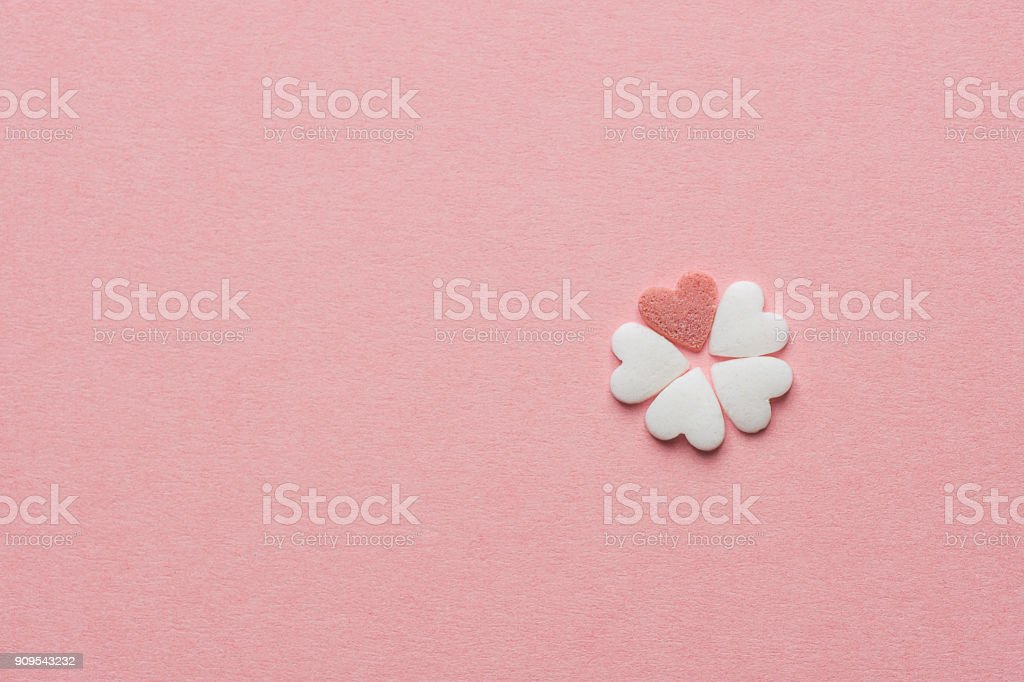 Small pretty flower made of heart shape sugar candy white and red