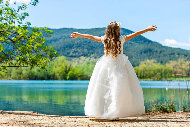 small princess in white dress at lake. - communion stock photos and pictures