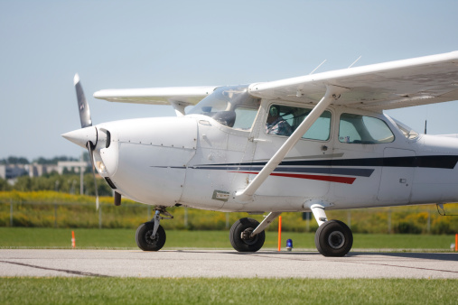 Private airplane accident. Airplane flipped in field short of runway. (All passengers walked away.) Cessna 172.