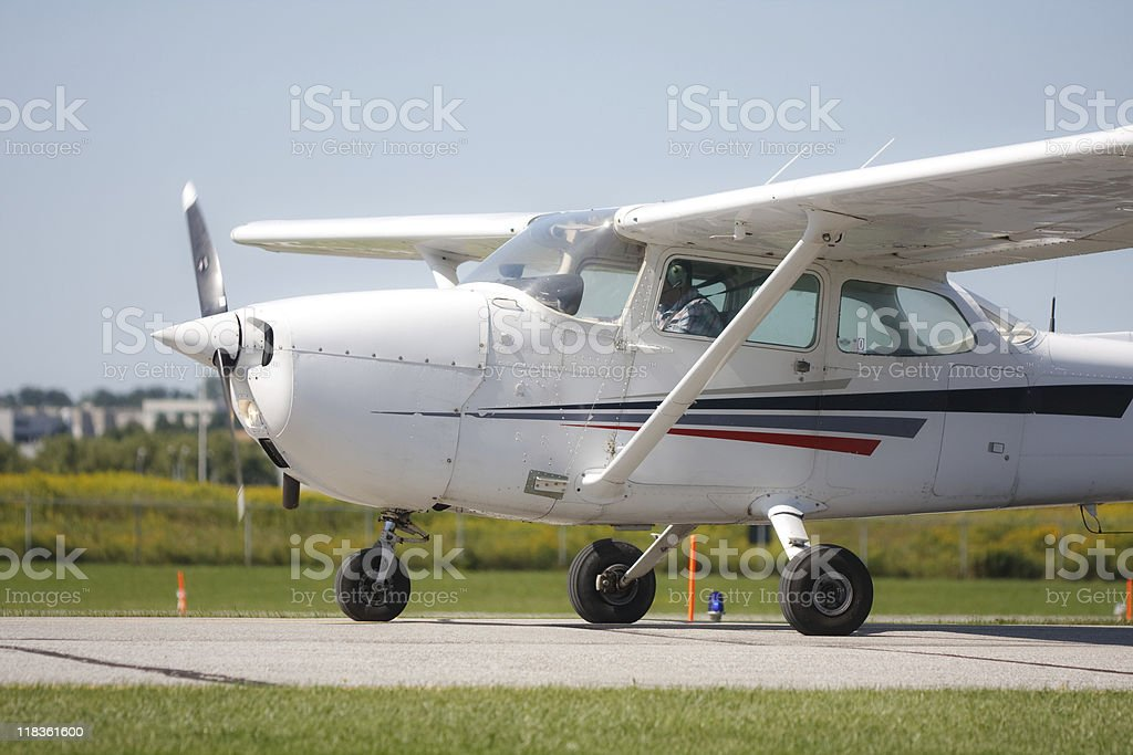Small prop plane ready for takeoff stock photo