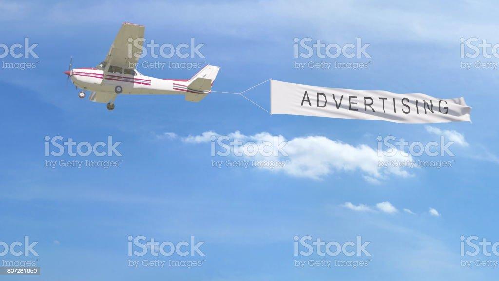 Avion de petite hélice remorquage bannière avec légende de publicité dans le ciel. Rendu 3D - Photo