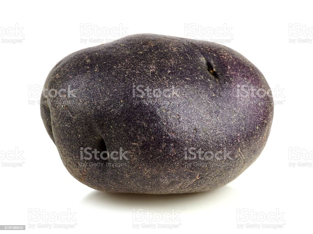 Small purple potato isolated on white stock photo