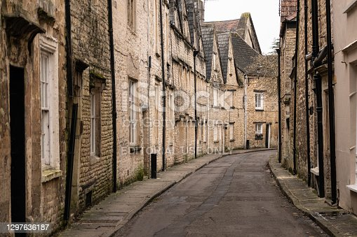 Small quant, street lined with historical old houses dating back to the 18th Century in the Cotswold town of Cirencester.