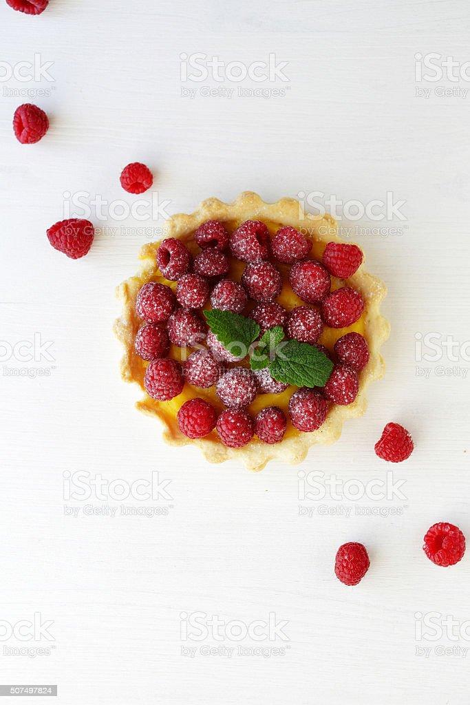 small raspberry tart on white stock photo