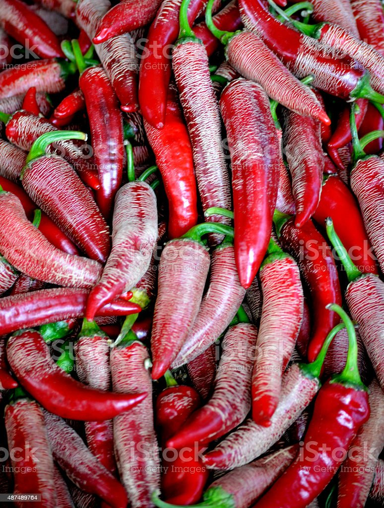 Small, red and very hot chili peppers stock photo