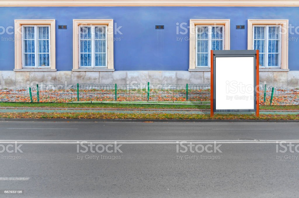 Small red blank billboard for media business advert on the road royalty-free stock photo