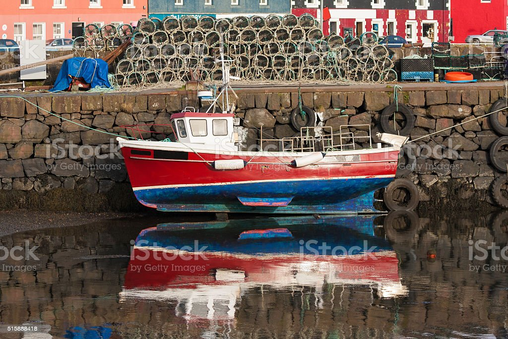 small red fishing boat in tobermory stock photo