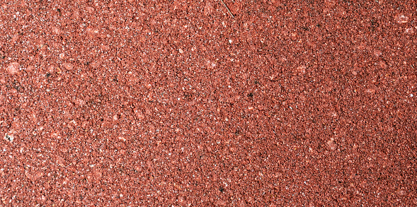 Small red gravel stones texture background